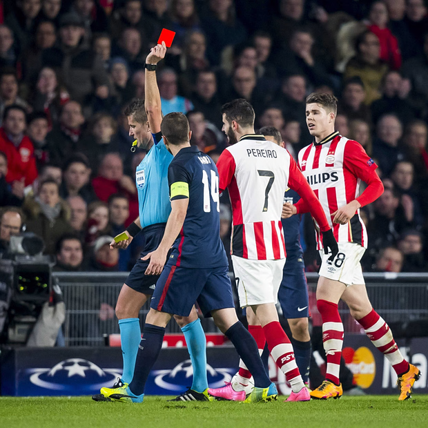 Pereiro gets booked - Image Source: The Guardian