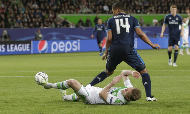 Andre Schurrle fouled by Casemiro in the box.