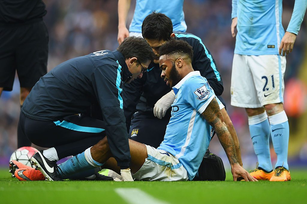 MANCHESTER, ENGLAND - MARCH 20: An injured Raheem Sterling of Manchester City is given treatment during the Barclays Premier League match between Manchester City and Manchester United at Etihad Stadium on March 20, 2016 in Manchester, United Kingdom. (Photo by Laurence Griffiths/Getty Images)