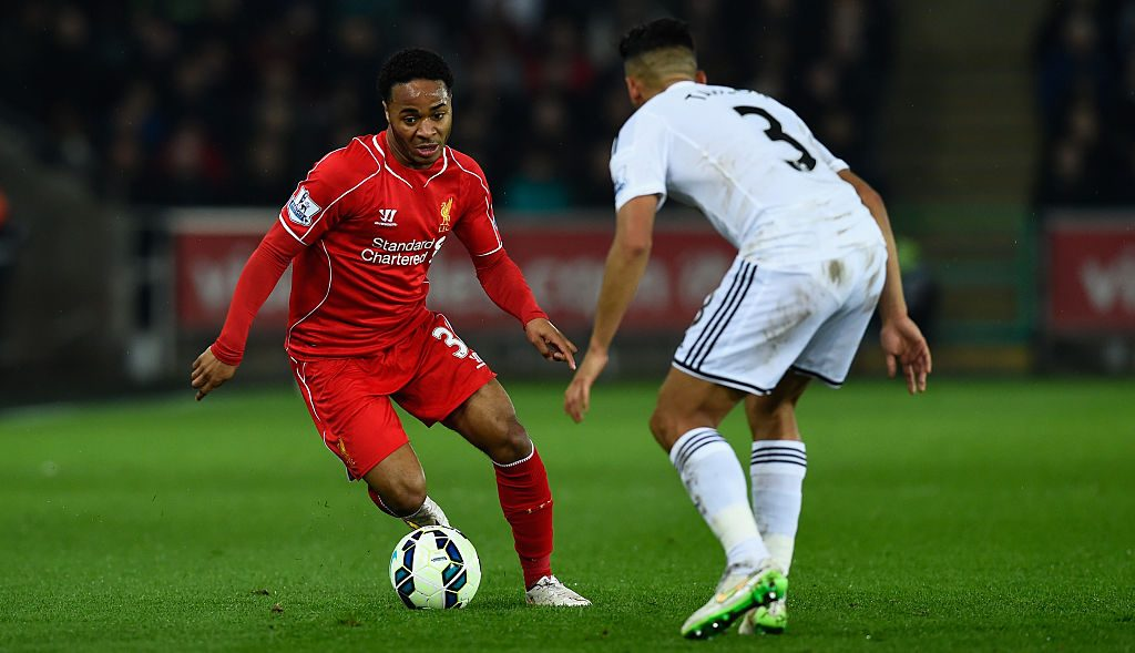 SWANSEA, WALES - MARCH 16: Liverpool player Raheem Sterling (l) takes on Neil Taylor of Swansea during the Barclays Premiership match between Swansea City and Liverpool at Liberty Stadium on March 16, 2015 in Swansea, Wales. (Photo by Stu Forster/Getty Images)