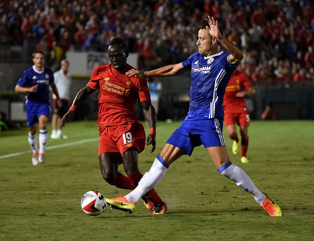 Chelsea's defender John Terry (R) tackles Liverpool's forward Sadio Mane (L) during their International Champions Cup (ICC) football match at the Rose Bowl Stadium in Pasadena, California on July 27, 2016. Chelsea won 1-0. / AFP / Mark Ralston (Photo credit should read MARK RALSTON/AFP/Getty Images)