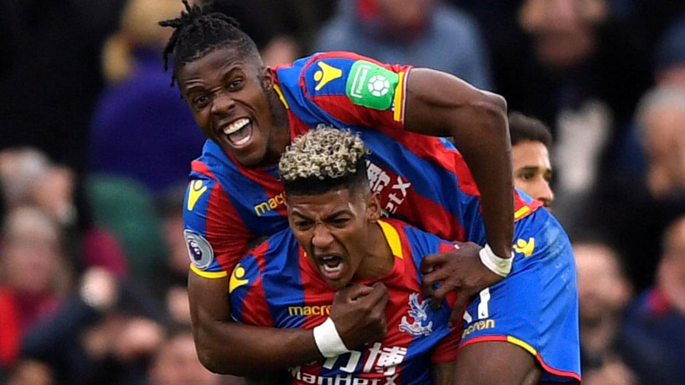Wilfried Zaha and Patrick van Aanholt are full of emotion