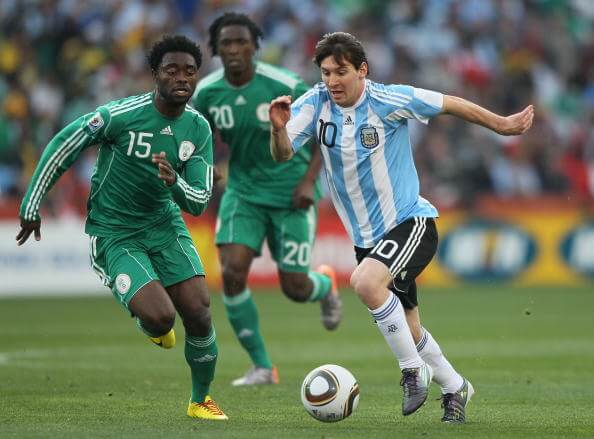 JOHANNESBURG, SOUTH AFRICA - JUNE 12: Sani Kaita of Nigeria chases Lionel Messi of Argentina during the 2010 FIFA World Cup South Africa Group B match between Argentina and Nigeria at Ellis Park Stadium on June 12, 2010 in Johannesburg, South Africa. (Photo by Christof Koepsel/Getty Images)