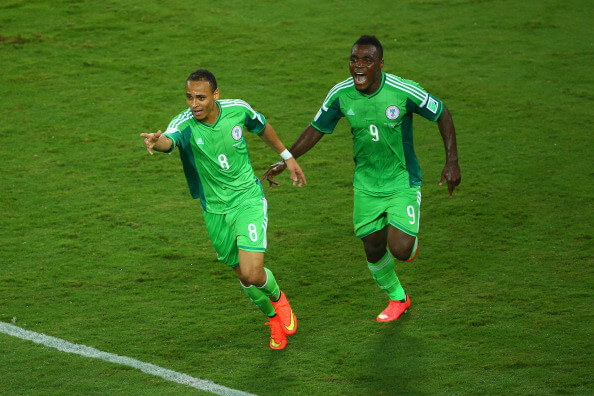 CUIABA, BRAZIL - JUNE 21: Peter Odemwingie of Nigeria (L) celebrates scoring his team's first goal with teammate Emmanuel Emenike during the 2014 FIFA World Cup Group F match between Nigeria and Bosnia-Herzegovina at Arena Pantanal on June 21, 2014 in Cuiaba, Brazil. (Photo by Clive Brunskill/Getty Images)