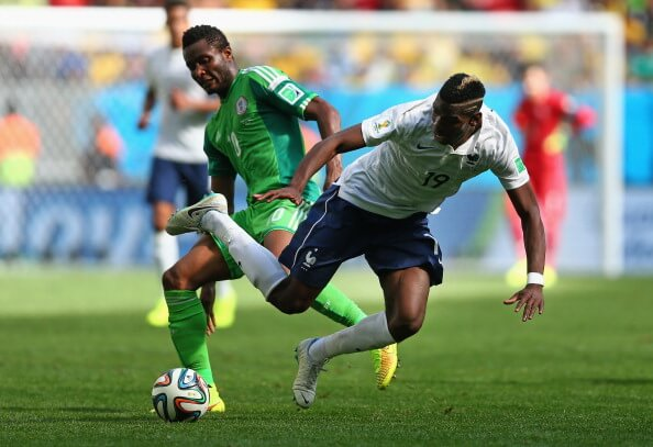 BRASILIA, BRAZIL - JUNE 30: John Obi Mikel of Nigeria challenges Paul Pogba of France during the 2014 FIFA World Cup Brazil Round of 16 match between France and Nigeria at Estadio Nacional on June 30, 2014 in Brasilia, Brazil. (Photo by Jeff Gross/Getty Images)