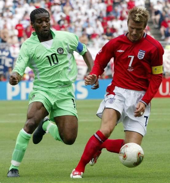 England's midfielder David Beckham (7) keeps the b