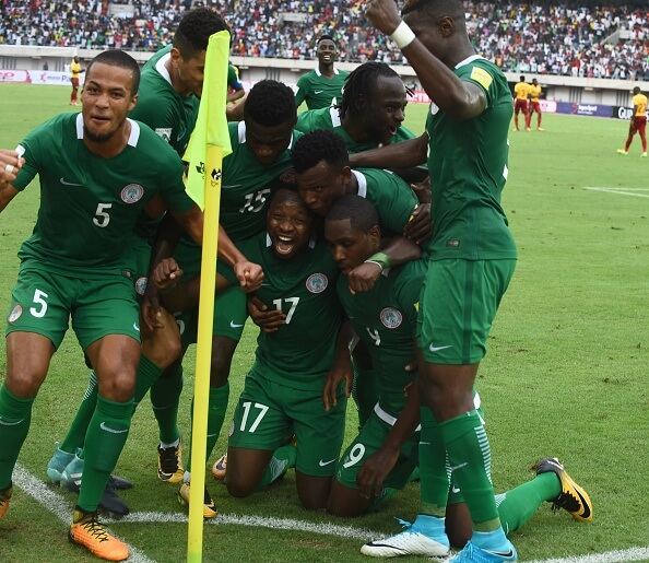Nigeria's players celebrate after scoring a goal during the 2018 FIFA World Cup qualifying football match between Nigeria and Cameroon at Godswill Akpabio International Stadium in Uyo, southern Nigeria, on September 1, 2017. / AFP PHOTO / PIUS UTOMI EKPEI (Photo credit should read PIUS UTOMI EKPEI/AFP/Getty Images)