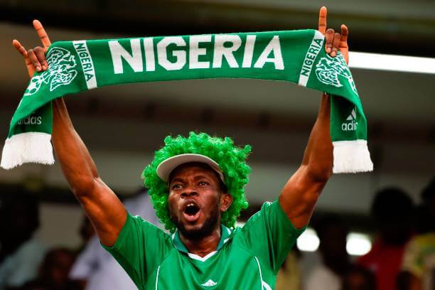 A Nigerian fan waves a scarf as he celebrates after the FIFA World Cup 2018 qualifying football match between Nigeria and Zambia in Uyo, Akwa Ibom State, on October 7, 2017. / AFP PHOTO / PIUS UTOMI EKPEI (Photo credit should read PIUS UTOMI EKPEI/AFP/Getty Images)