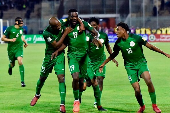 Nigeria's John Ogu (C) celebrates with teammates after scoring a goal during the 2018 FIFA World Cup Group B qualifying football match between Algeria and Nigeria at the Chahid Hamlaou Stadium in Constantine on November 10, 2017. / AFP PHOTO / RYAD KRAMDI (Photo credit should read RYAD KRAMDI/AFP/Getty Images)