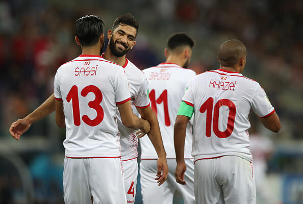 VOLGOGRAD, RUSSIA - JUNE 18: Ferjani Sassi of Tunisia is congratulated by Yassine Meriah of Tunisiaa after he scores a penalty during the 2018 FIFA World Cup Russia group G match between Tunisia and England at Volgograd Arena on June 18, 2018 in Volgograd, Russia. (Photo by Ian MacNicol/Getty Images)