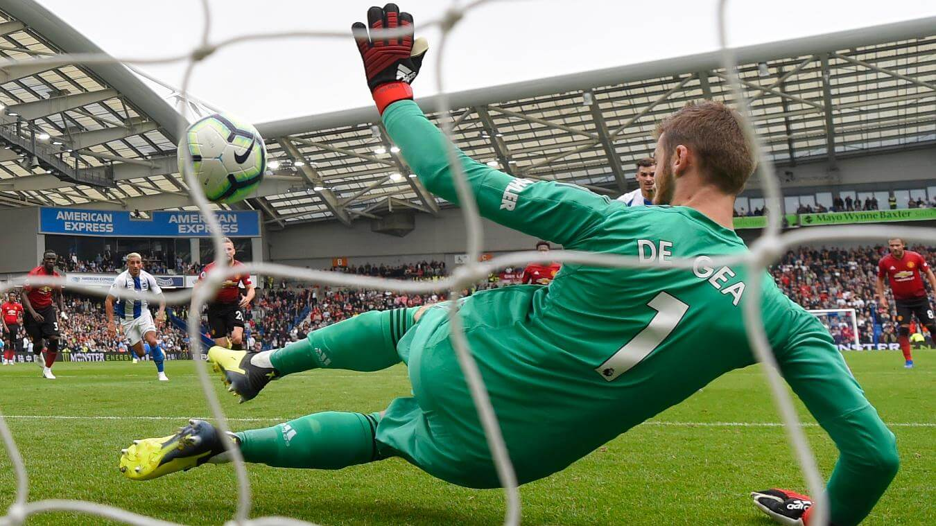 Pascal Gross scores his penalty past David De Gea